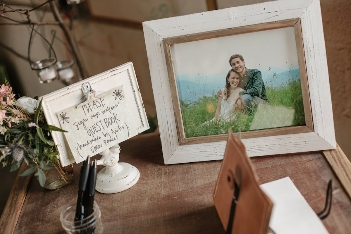 table with decoration pieces and Engagement Photo frame