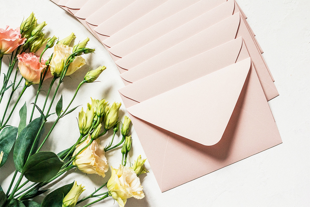 How To Stuff Wedding Invitations A Complete Guide Zola Expert Wedding Advice