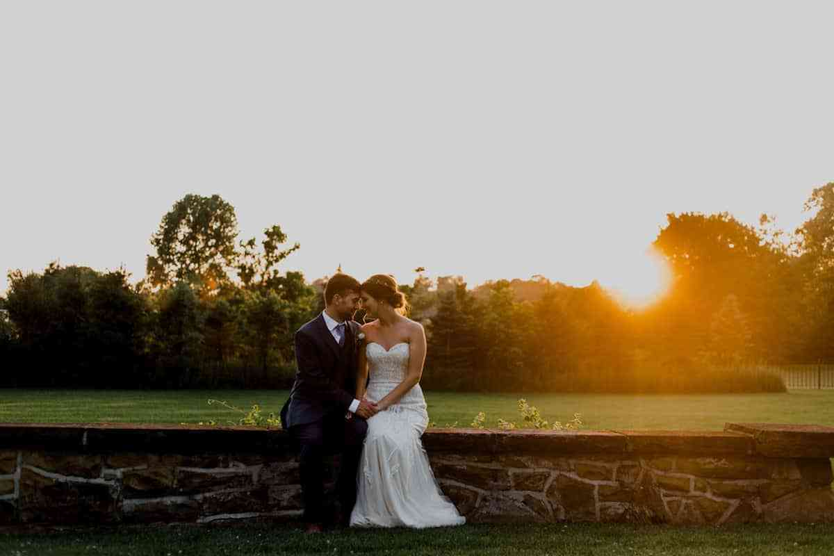 Bride and Groom posing in green outdoor and Sunset