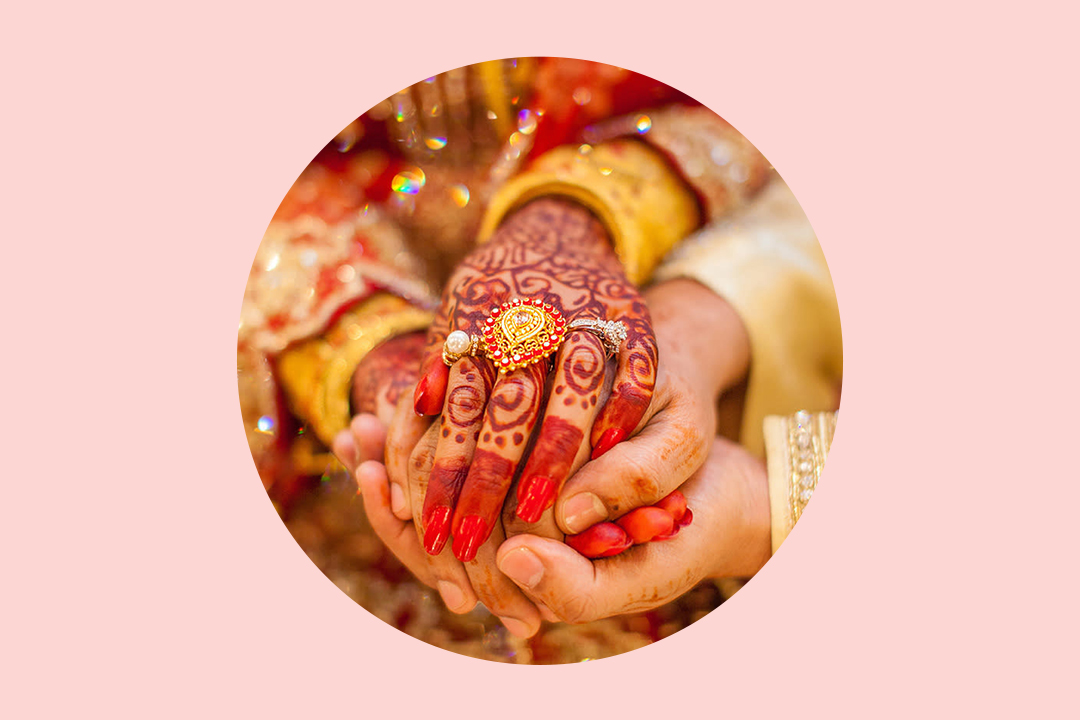 south asian indian wedding couple holding hands