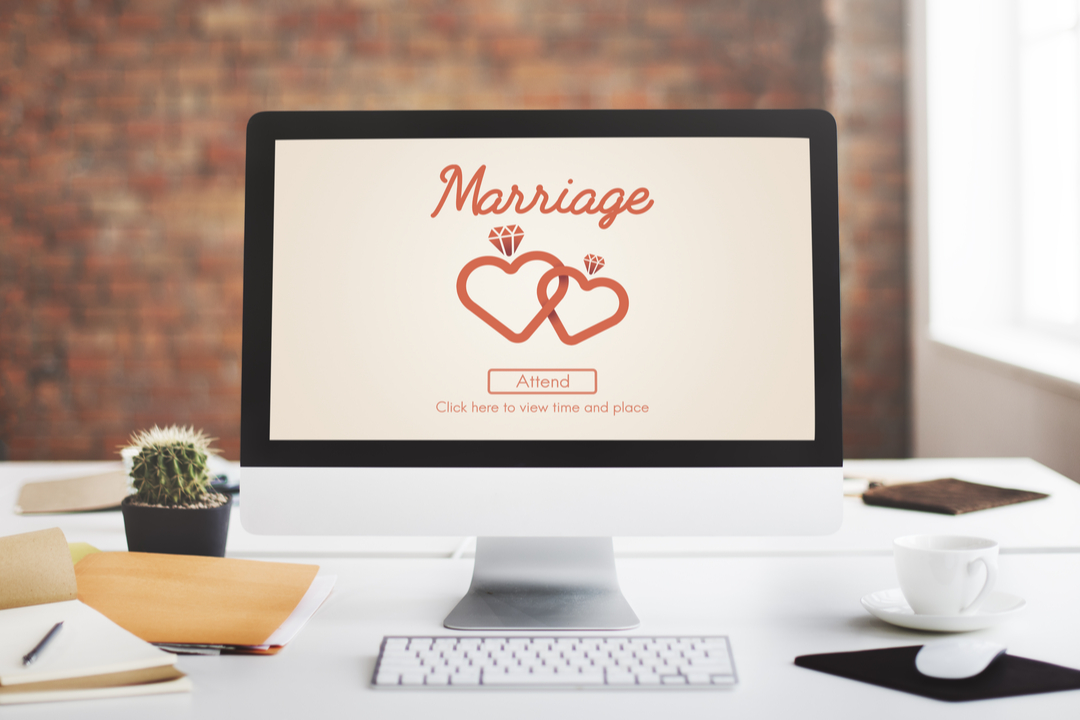 desktop with wedding website