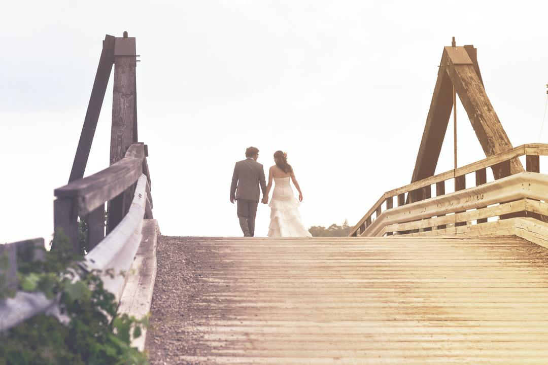 couple walking together on a bridge