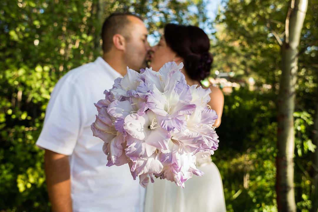 Couple kissing with flowers