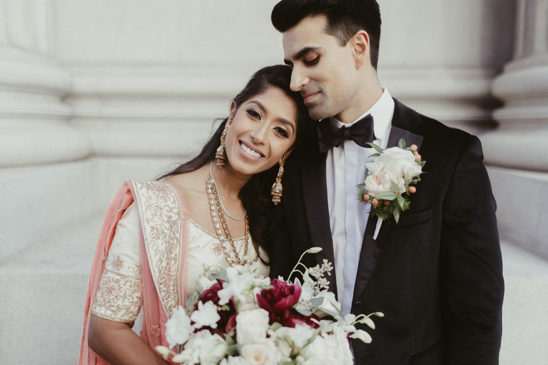 indian couple smiles at wedding ceremony