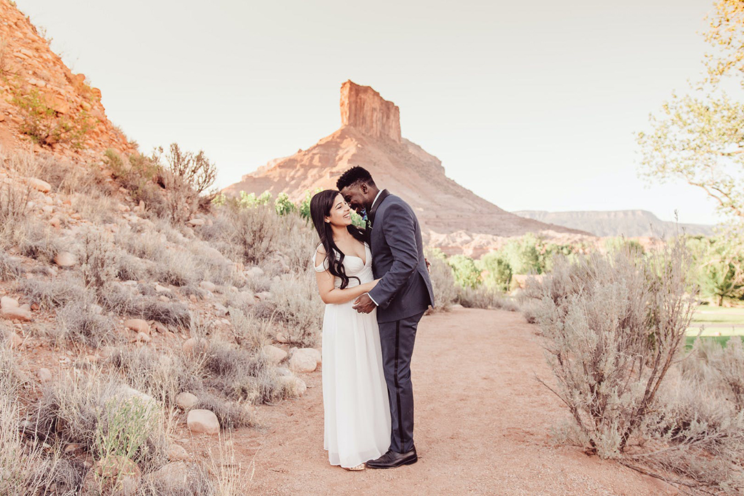 Couple embracing in desert