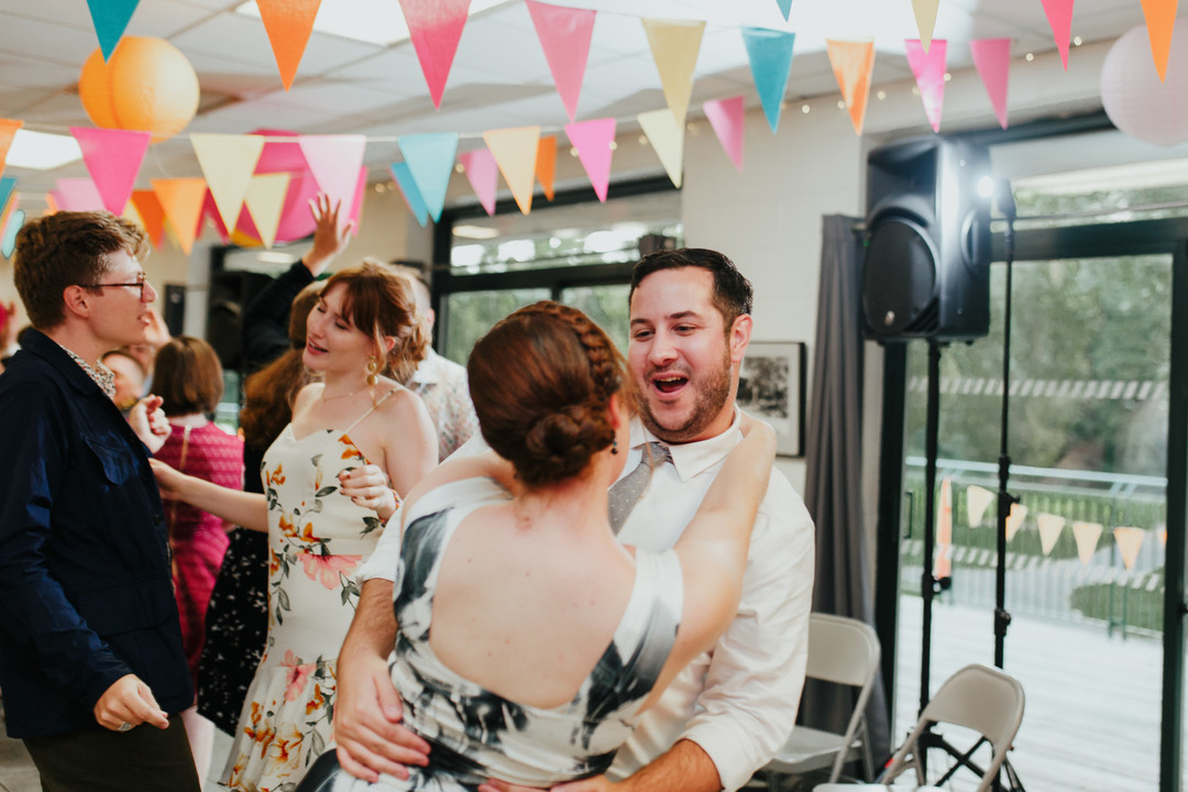 wedding guest dances with plus-one