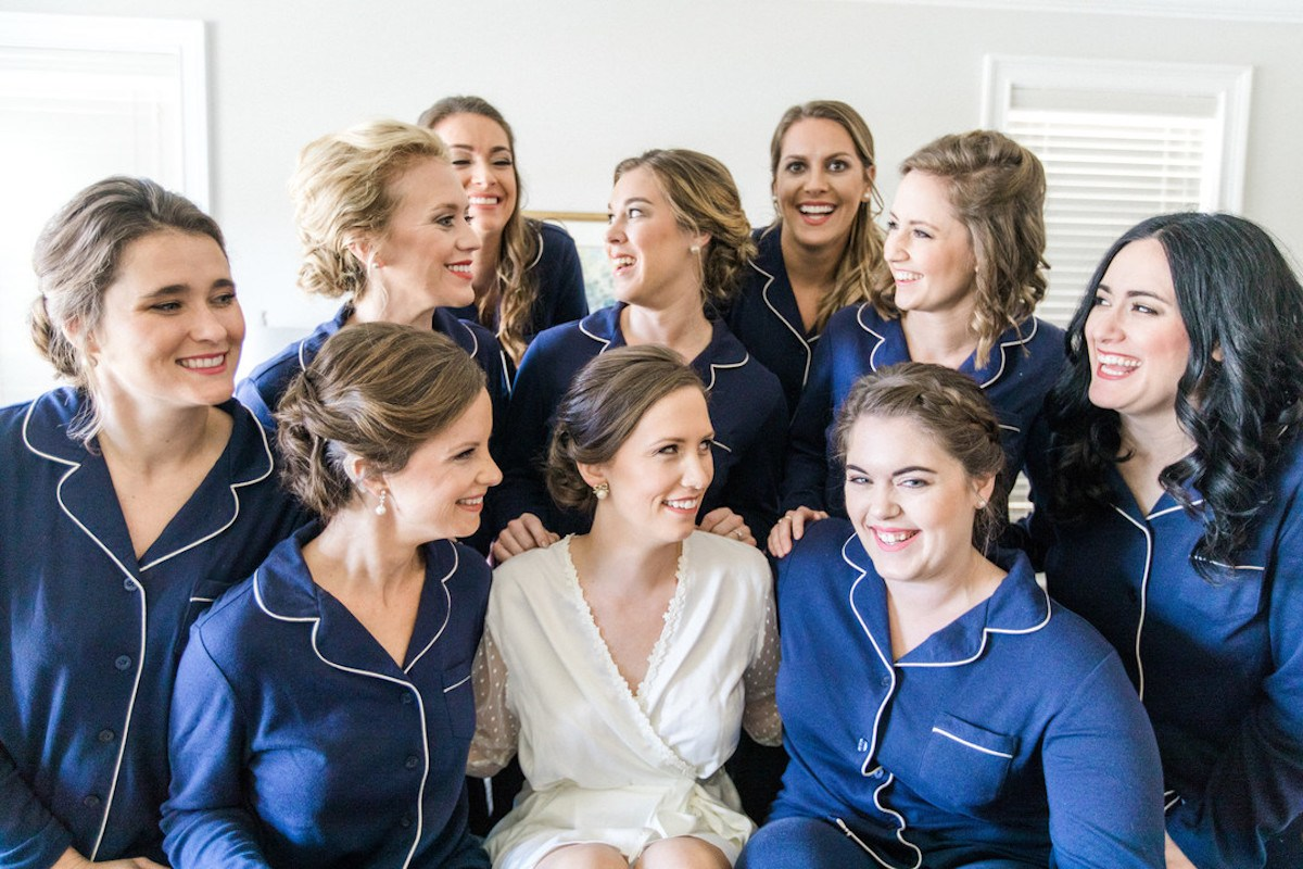 Bride in white and Bridesmaids in blue