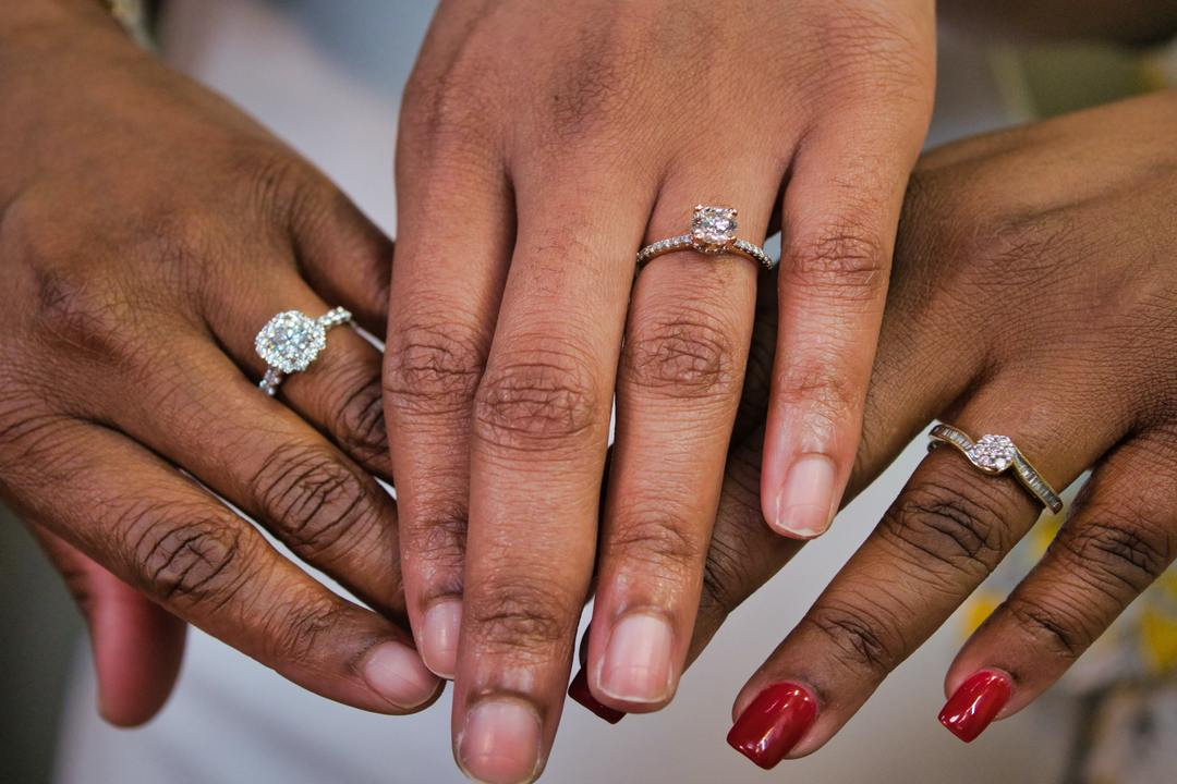 What Are the Different Diamond Cut Options? - group of hands with rings