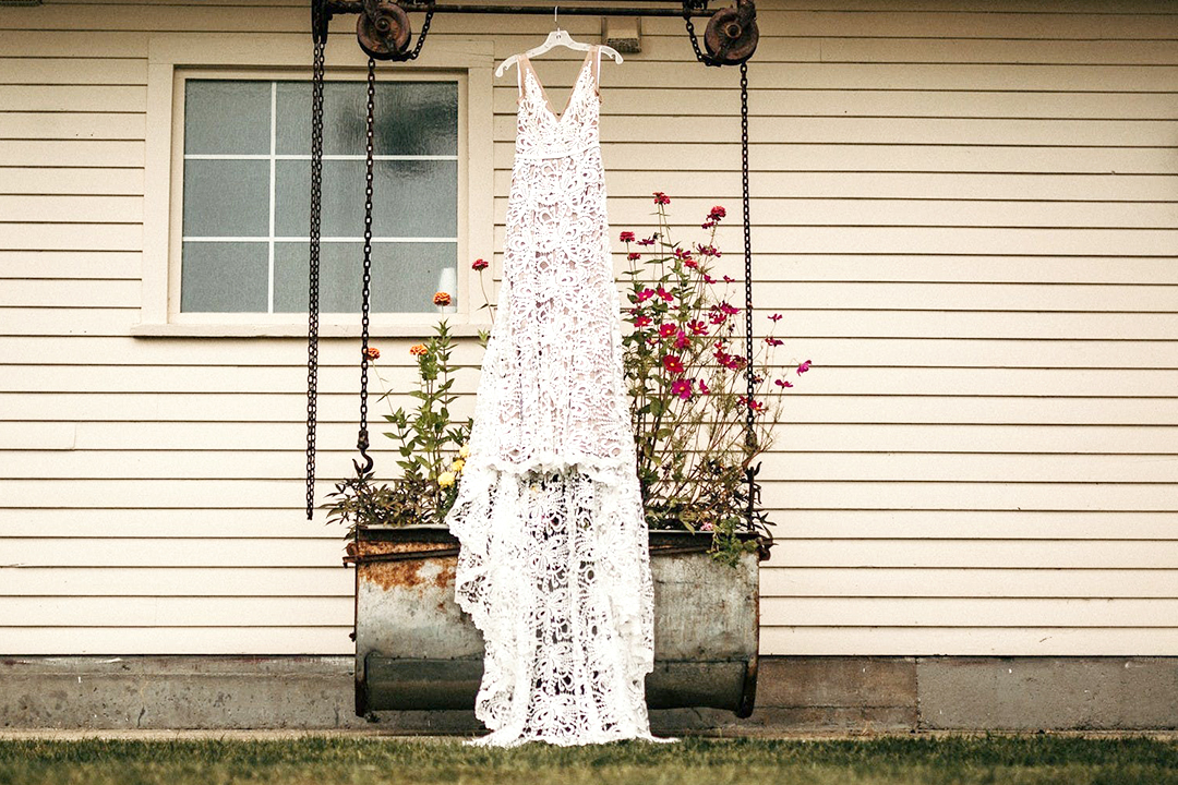 Wedding dress hung on display in garden
