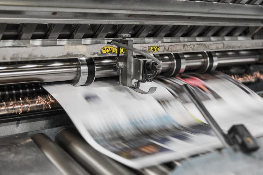 Commercial printer in process of printing a document or publication.