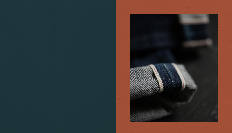 A cuffed jean leg showing the selvage.