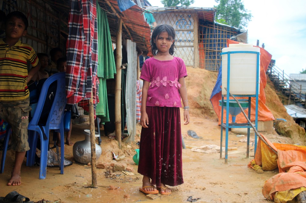 Halima outside her family's shelter