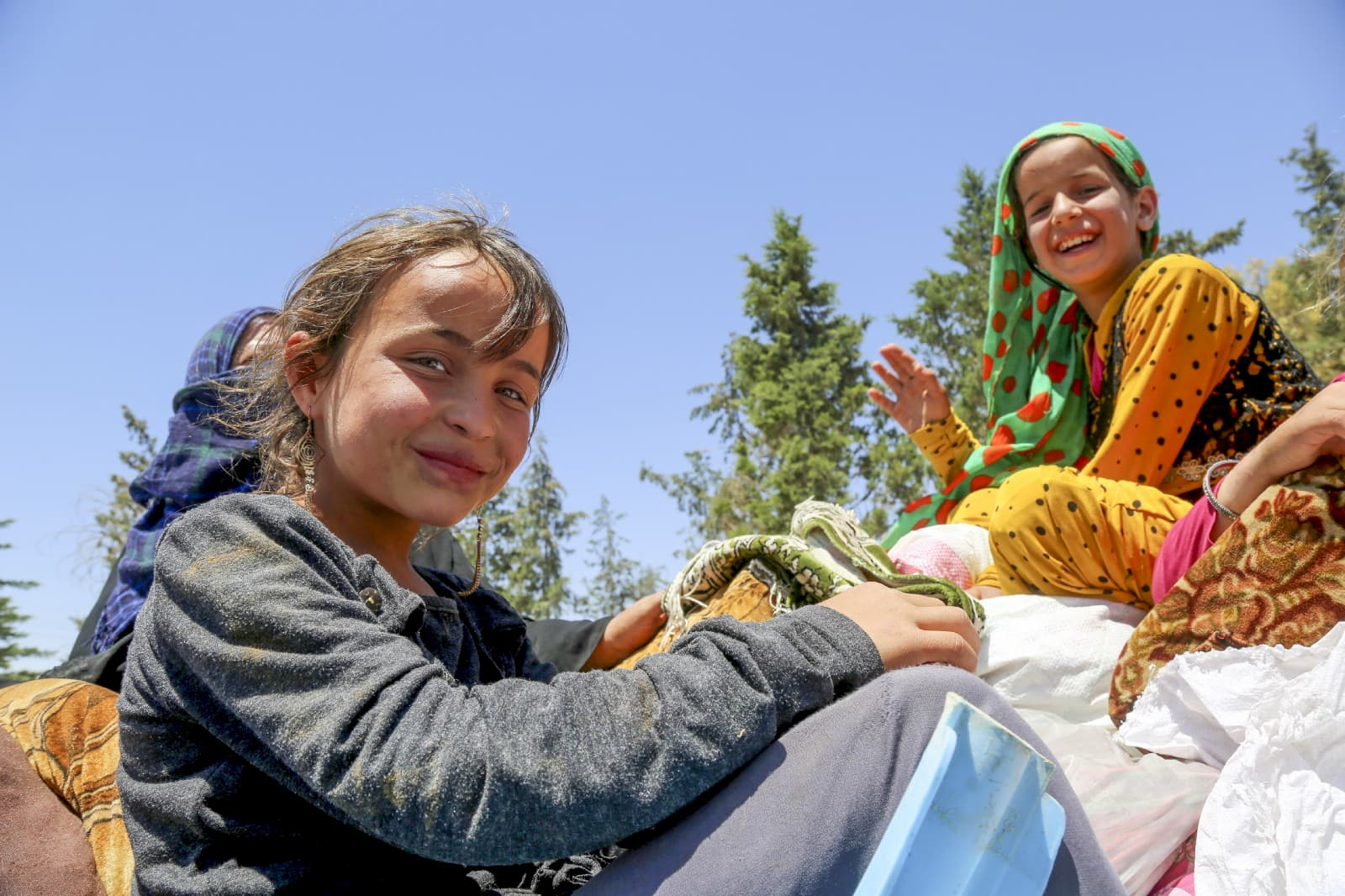 Hiba, 12, and her family in Ain Issa camp