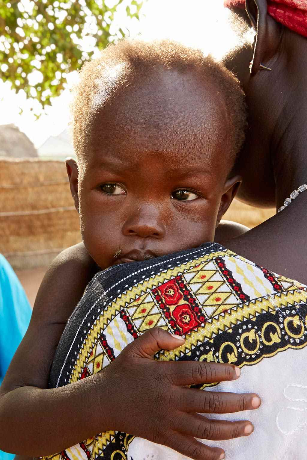 Adut holds onto her mother