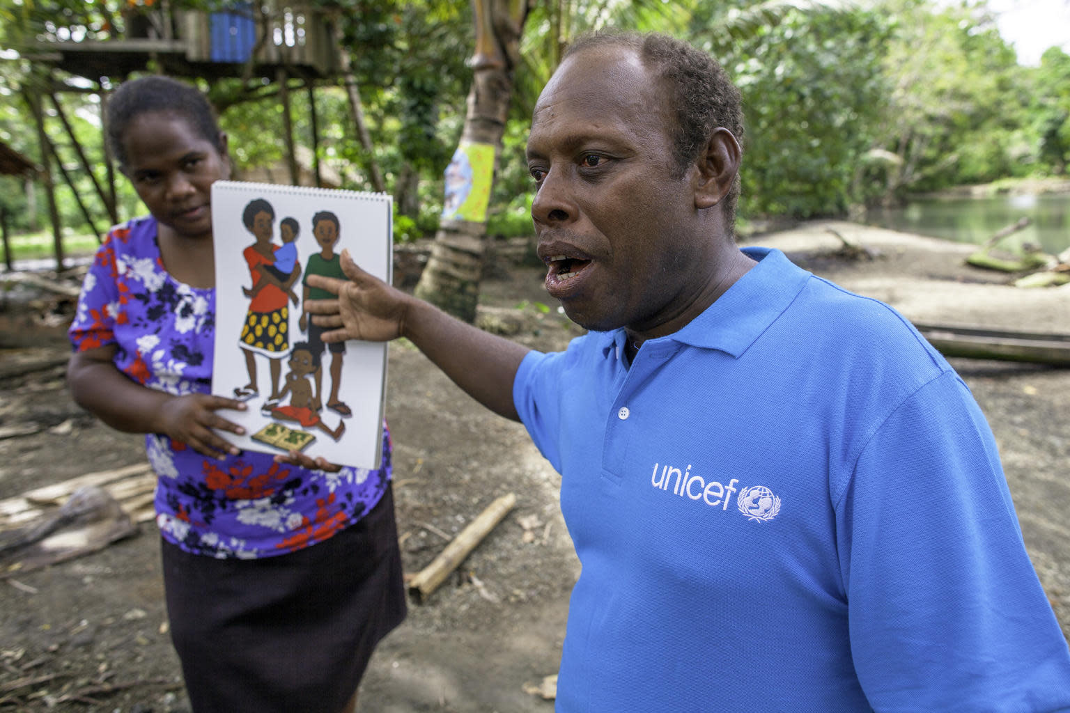 UNICEF Health Worker Paul Maesiala advises mothers and educates families on the importance of a nutritious diet