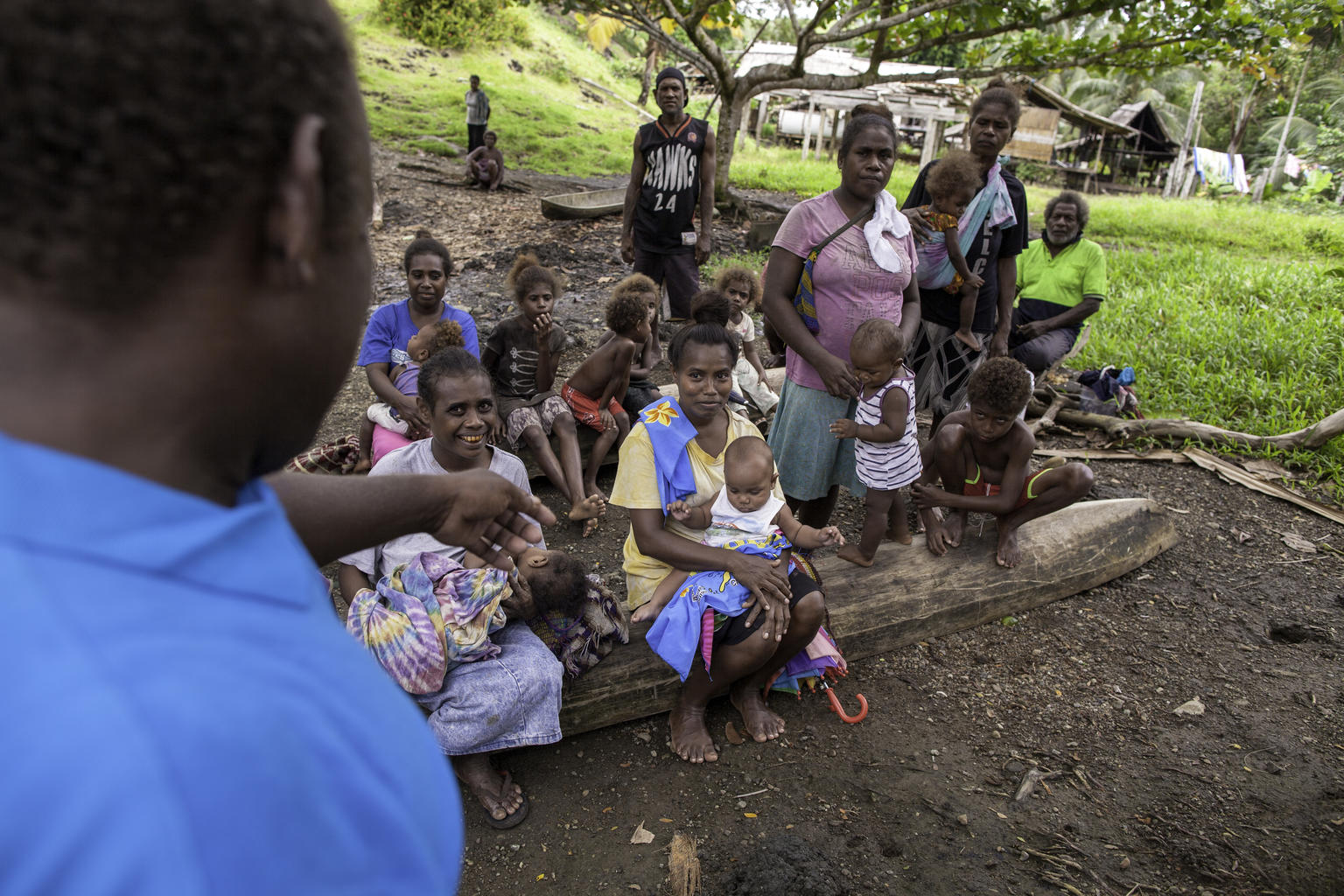 UNICEF Health Worker Paul Maesiala gives nutrition advice to a community in the Solomon Islands