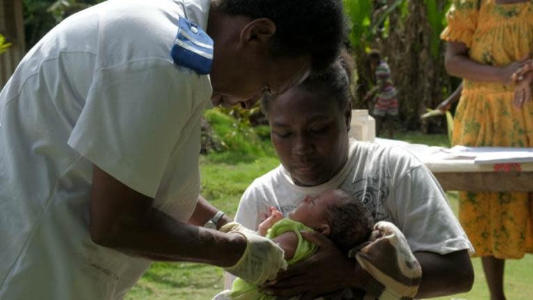 Registered nurse, Miriam Nampil, administers the first vaccine delivery in Cooks Bay, Vanuatu.