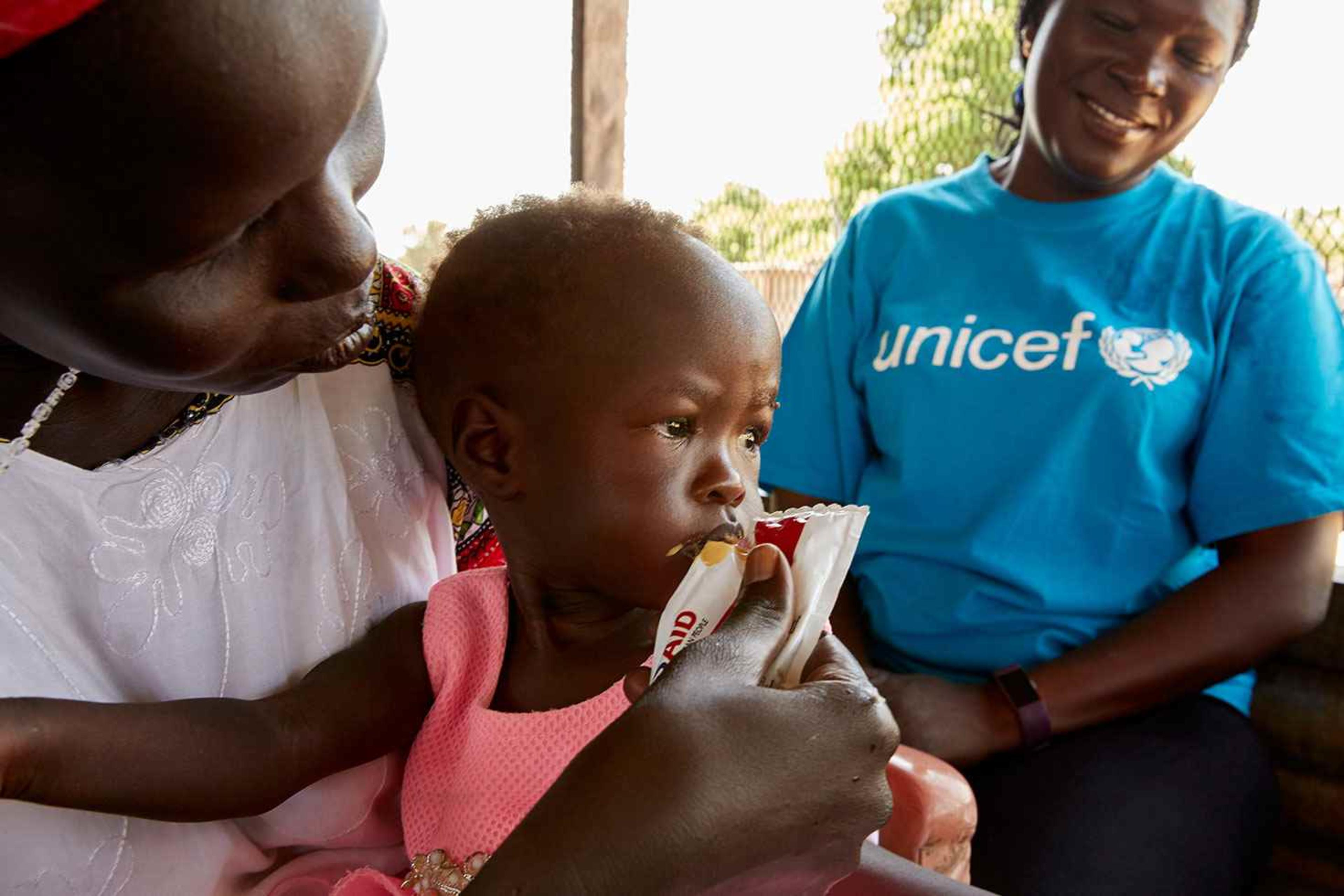 Adut's mother feeds her during her recovery from malnutrition