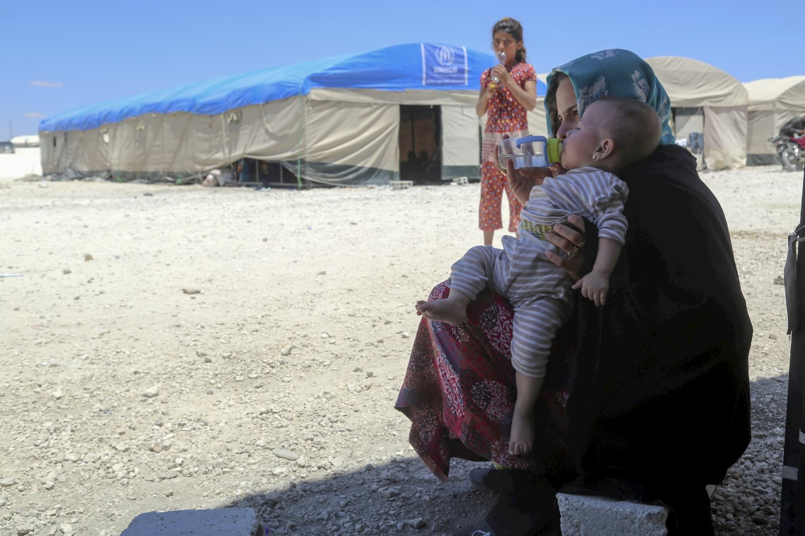 Mothers and children in the makeshift camp in Ain Issa