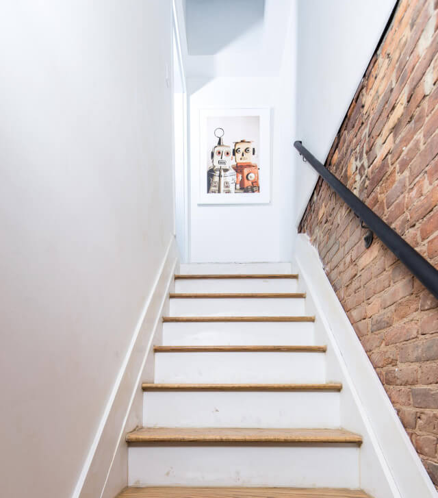 At Common Albany, your home is fully furnished from bedroom furniture to art in the staircases.