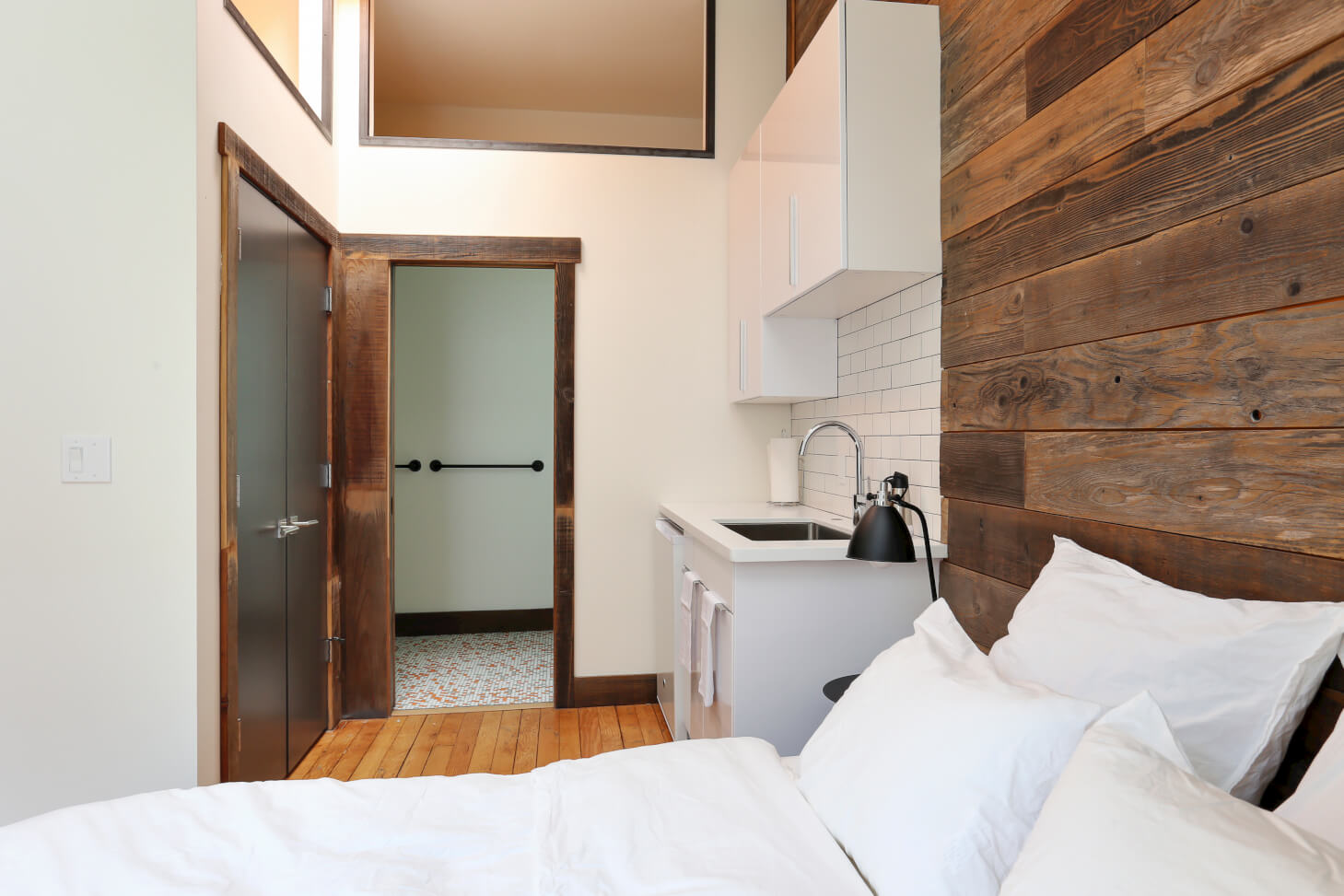 Some bedrooms at Common Minna in SoMa, San Francisco feature kitchenettes within your bedroom.
