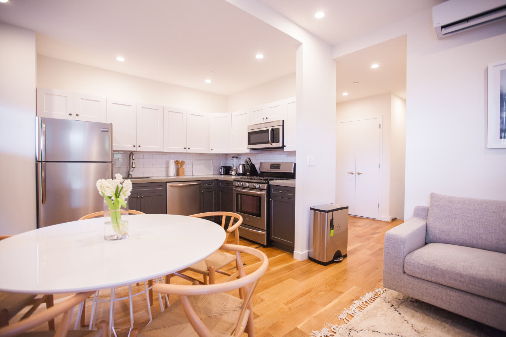 Every coliving suite at Common has a high-end kitchen and fully furnished living room.
