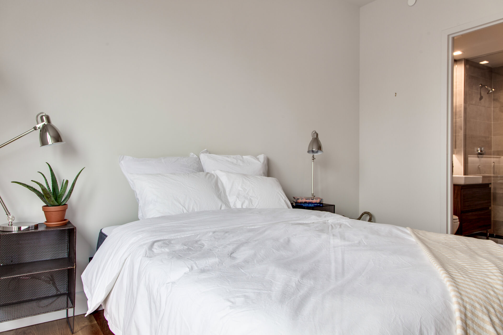 A private bedroom with ensuite bathroom at Common Baltic in Boerum Hill, Brooklyn.
