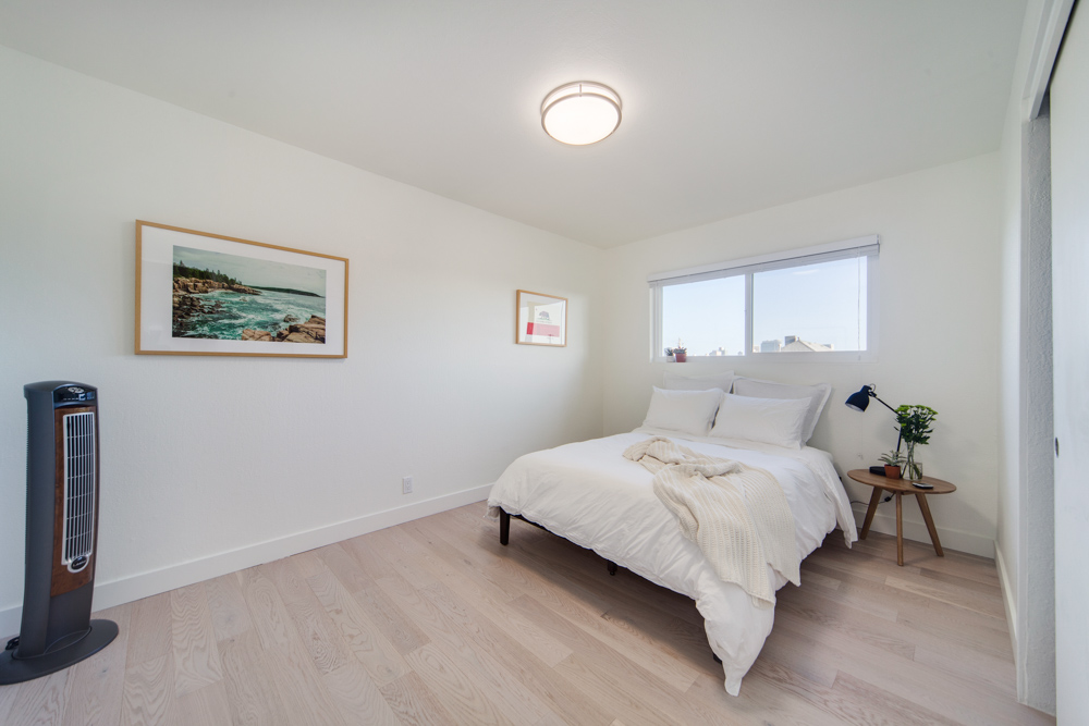 A beautifully furnished bedroom at Common MacArthur in San Francisco.