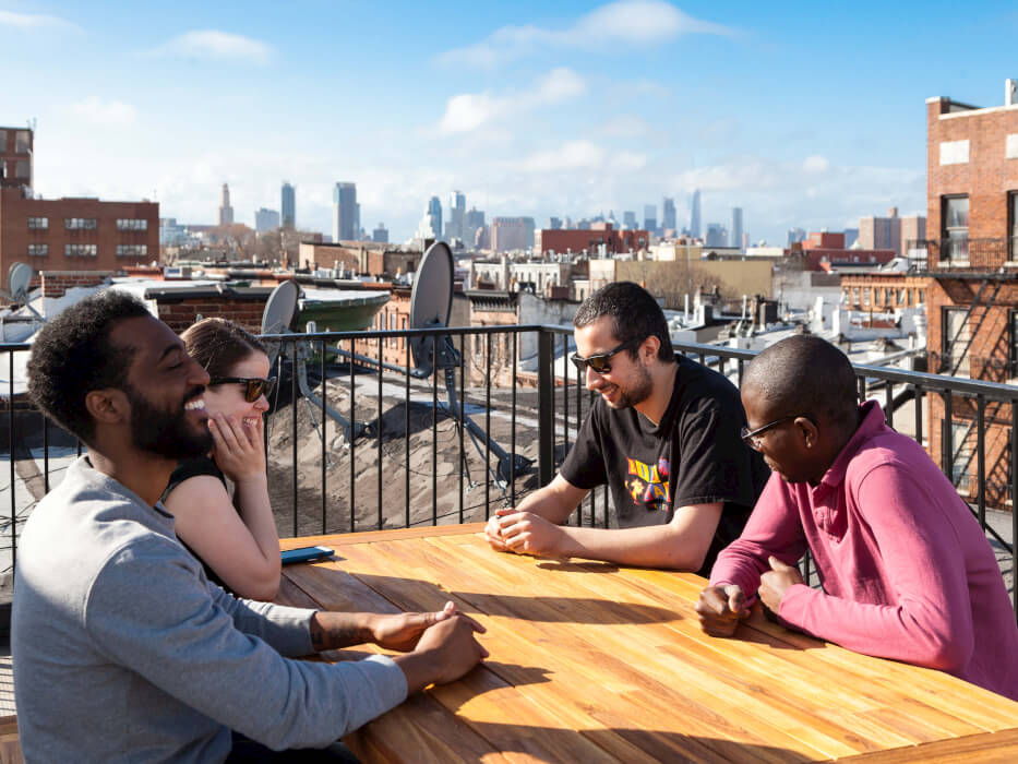 Members of Common Herkimer in Crown Heights, Brooklyn enjoy hanging out on their private rooftop.
