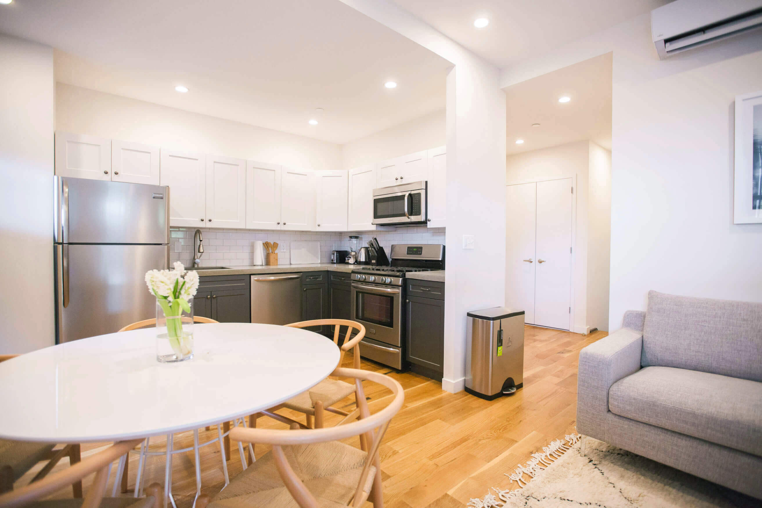 Pictured: a shared space at Common Havemeyer. All shared spaces in Common's coliving suites have a high-end kitchen and a fully furnished living room.