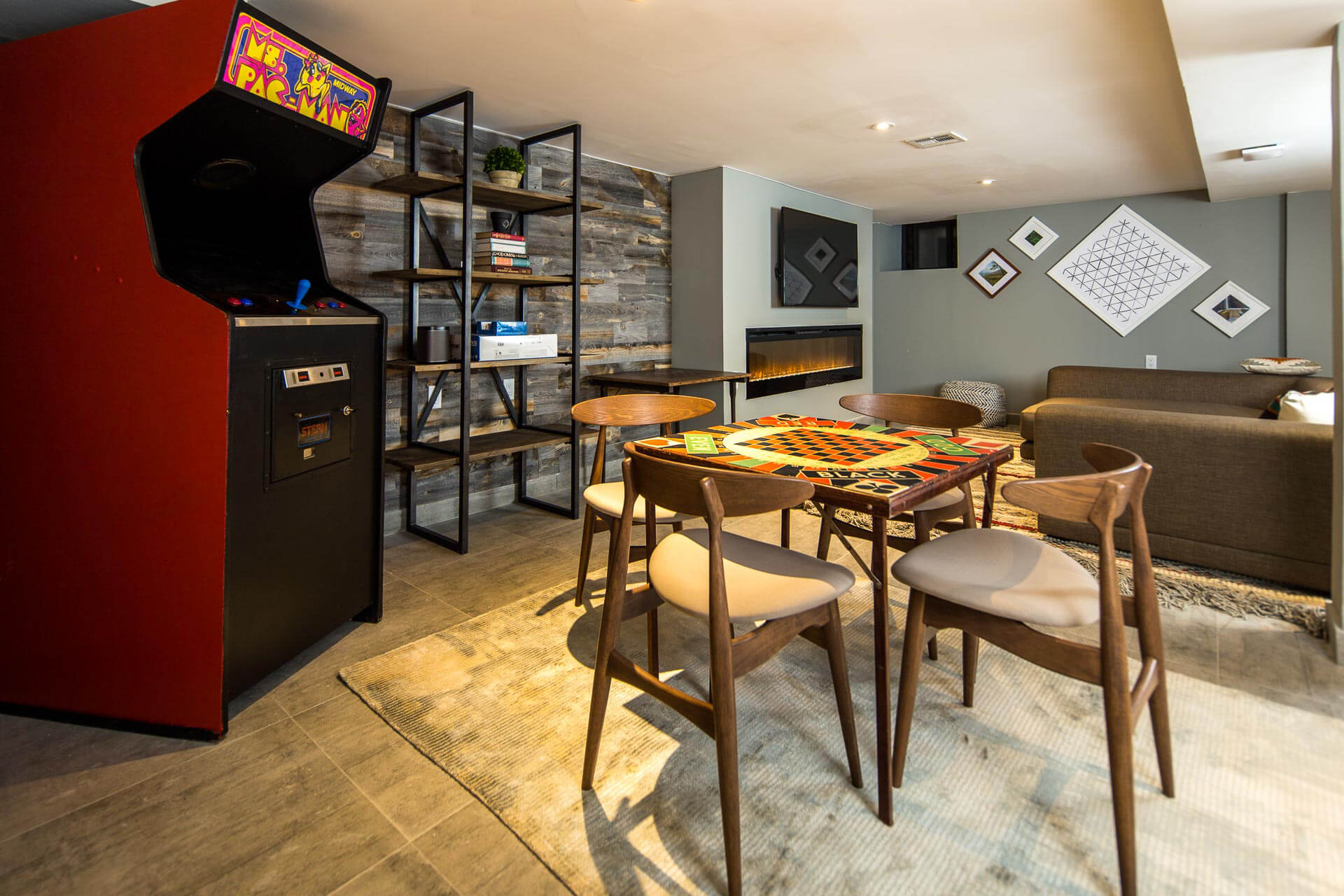 The Game Room at Common Albany is a space shared by all members in the home.
