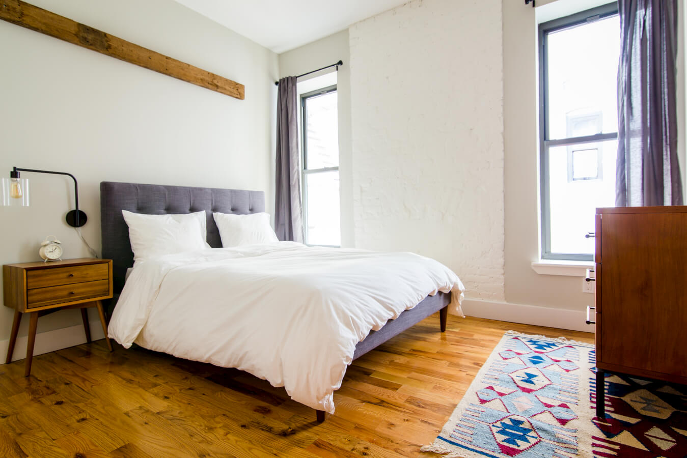 A fully furnished bedroom in a coliving suite at Common Pacific in Brooklyn, NY.