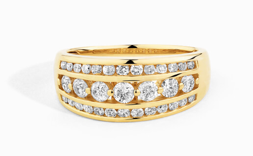 Bold fashion ring with three rows of diamonds in yellow gold.