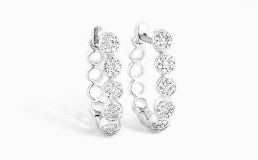 Sparkly diamond huggie earrings with bubble texture.