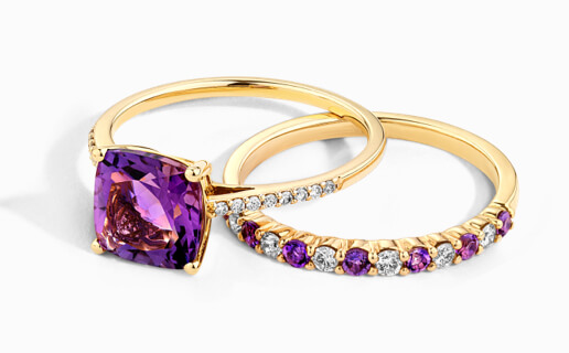 Garnet Ring set in yellow gold with diamond shoulders, and alternativing Diamond and Garnet band in yellow gold from Michael Hill