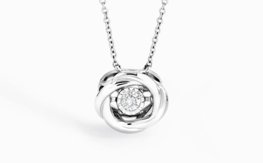 Open circle-shaped silver pendant with a diamond centre.