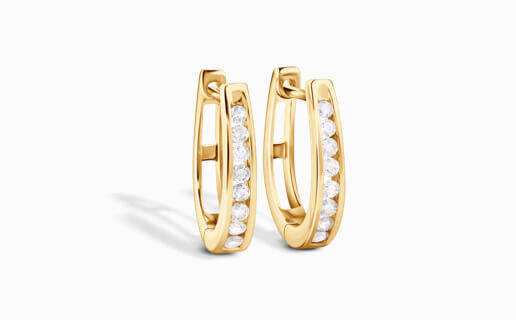 Huggie Earrings of Diamonds in Yellow Gold