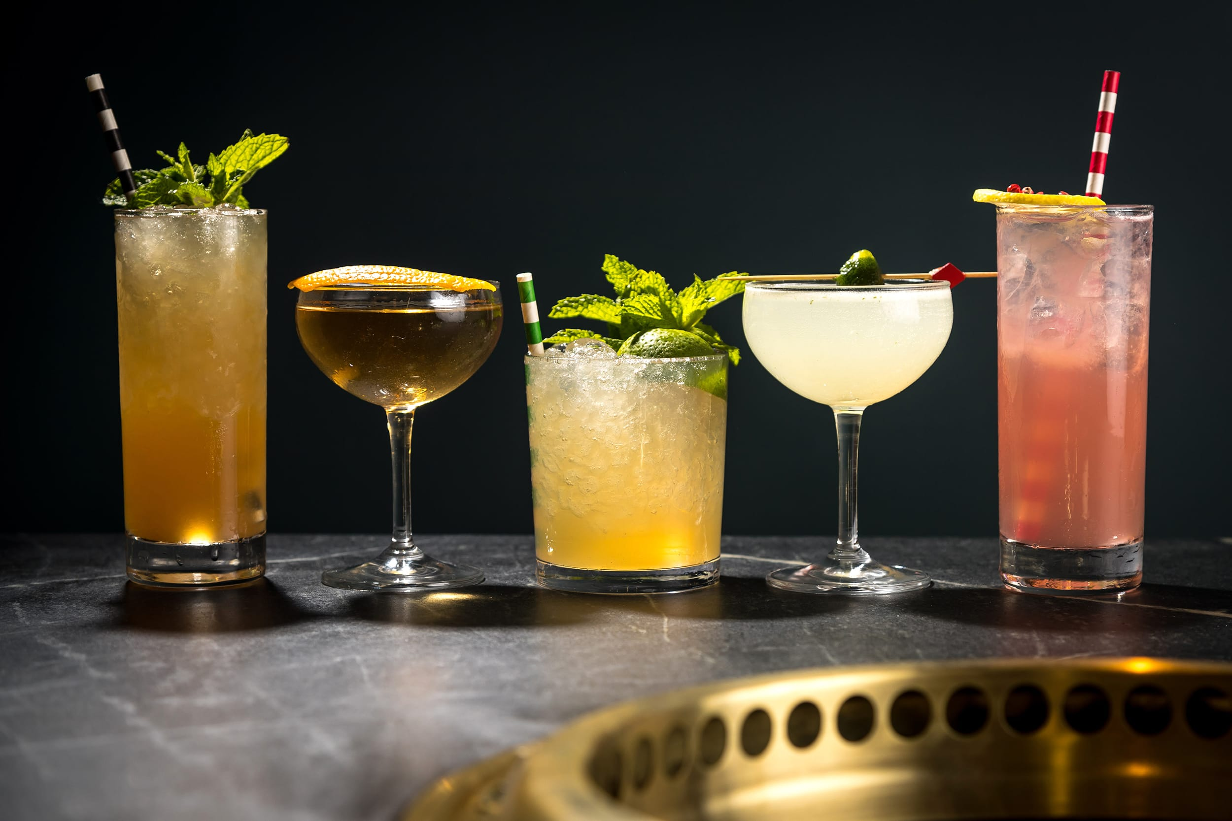 Five unique cocktails on a table