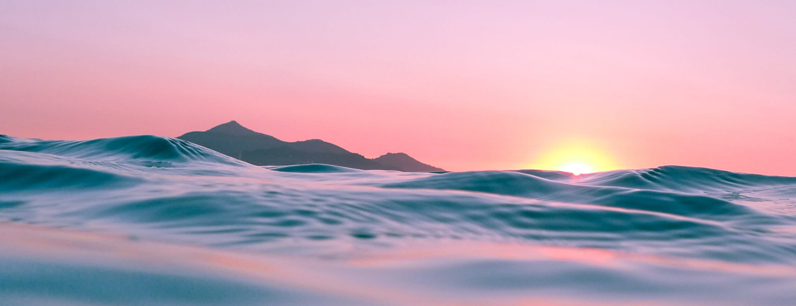 small waves with sunset representing the fixed income markets