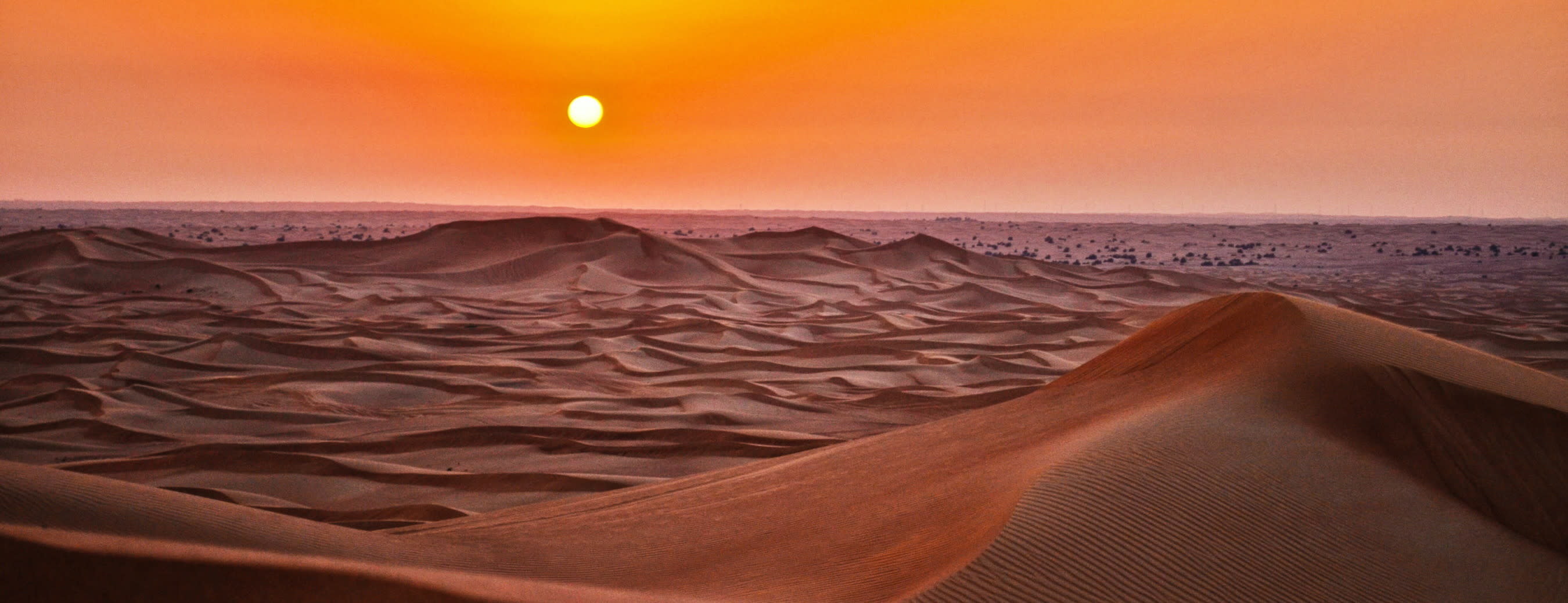 Sand dunes in a desert representing the heat of the markets