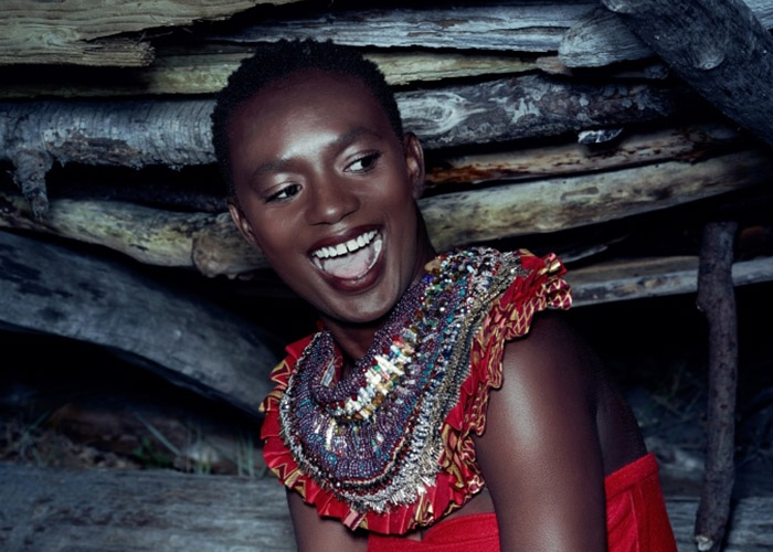 Designer, Anita Quansah created a dramic collar using your paper beads, glass beads, safety pins, cloth and other materials. This collar was auctioned to provide even more funds to charity:water's efforts in Tanzania.