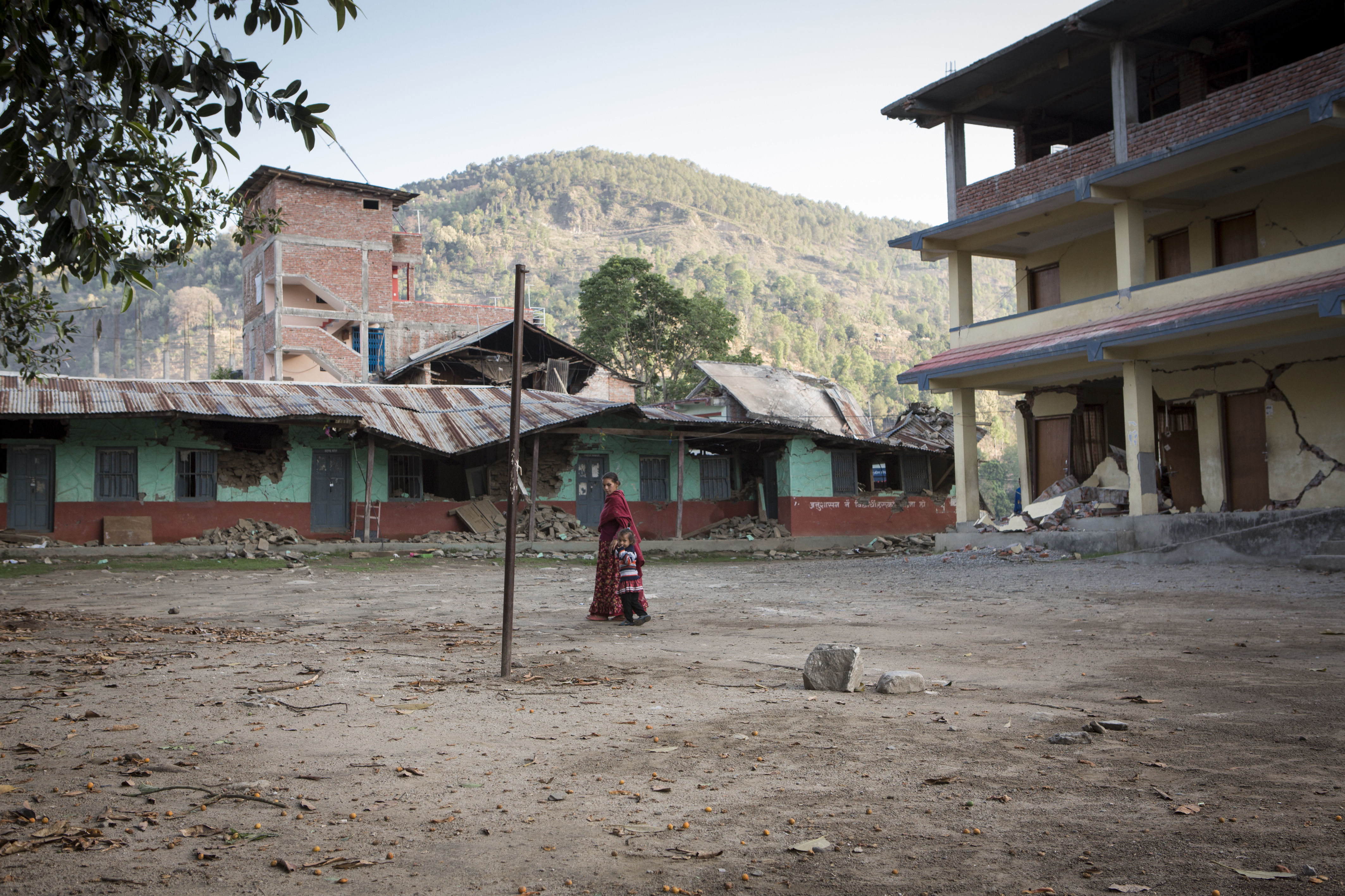 Touring the gounds of a damaged school in Nepal.