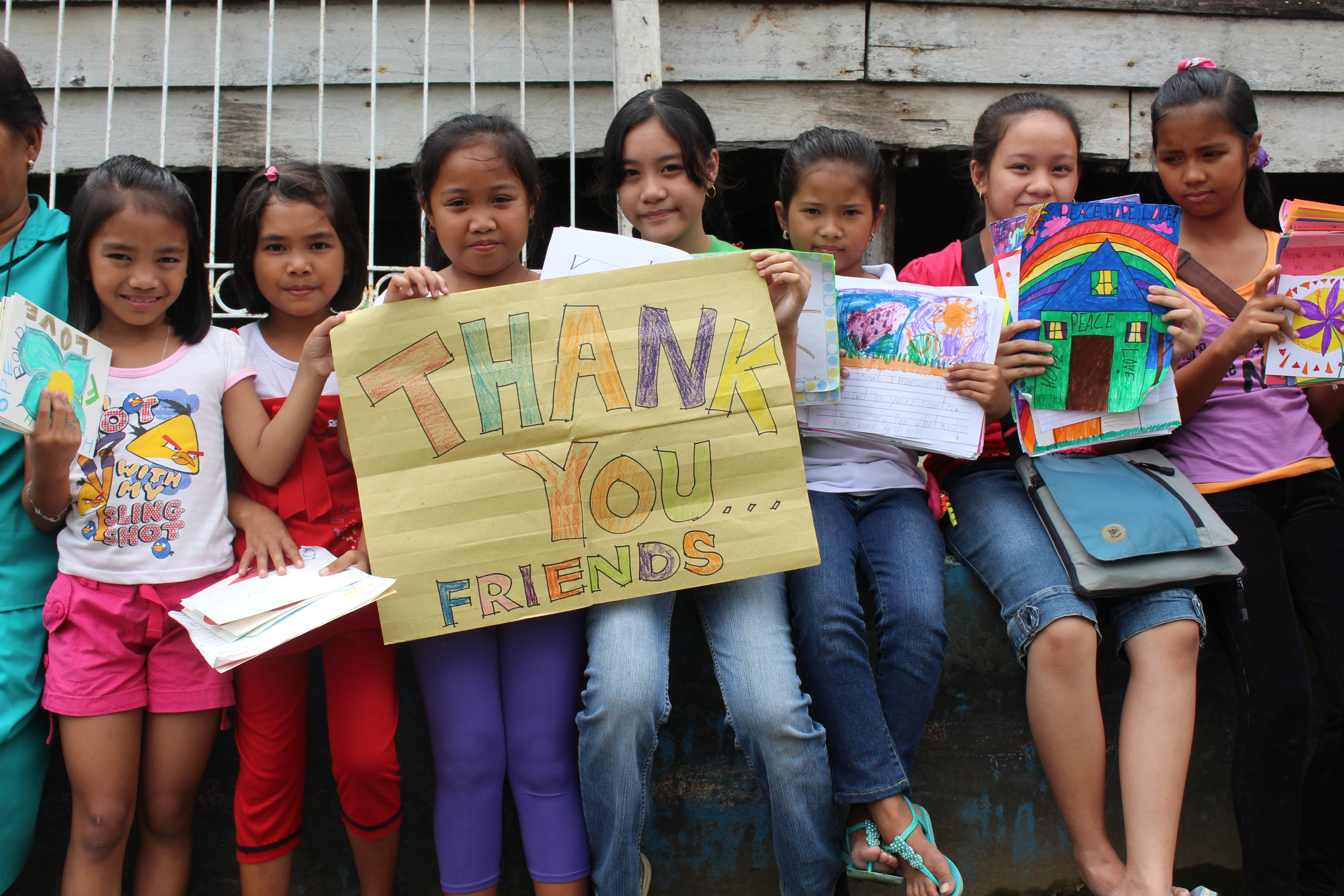 Students in the Philippines with letters written during the Challenge.