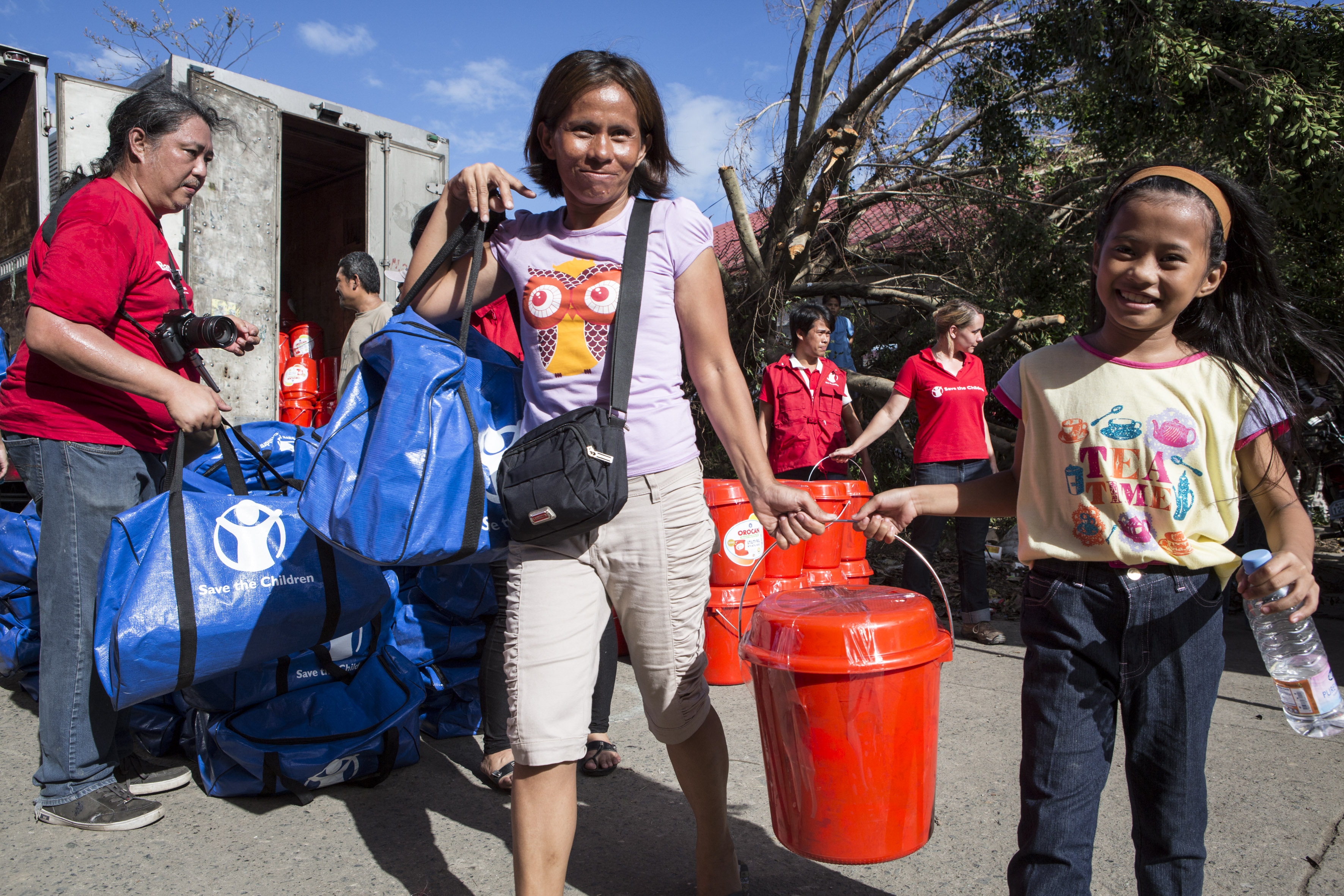 Beneficiaries with supplies from Save the Children.