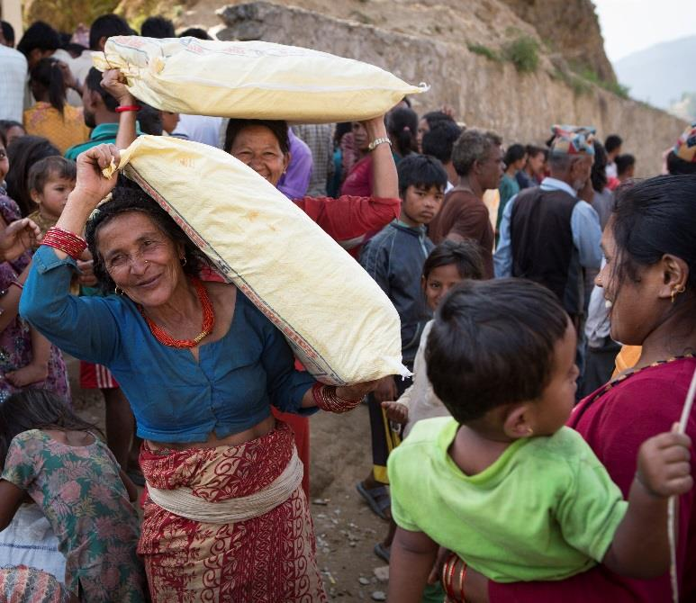 Women carrying shelter kits in Nepal.