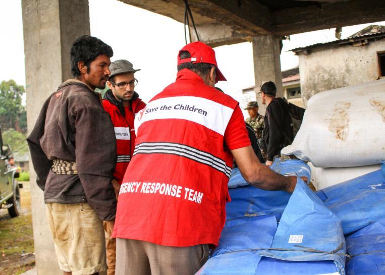 The Save the Children emergency response team unloading supplies in Nepal.