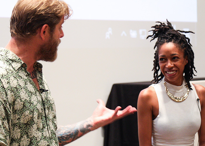 Afiya Williams and Arno Michaelis speaking at the opening event for the Facing Difference exhibit in the Figge Art Museum of Davenport, IA.