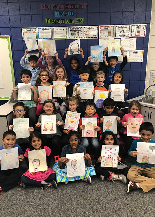 Ms. Musa's 2nd Graders with their finished portraits!