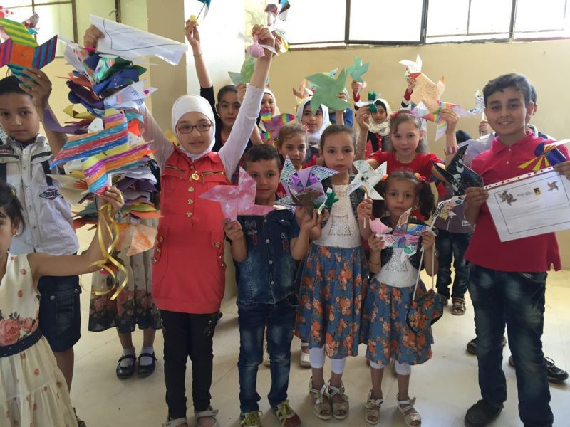 Some of the pinwheels you made for the Healing Classrooms Challenge made their way to a Healing Classroom in Syria!