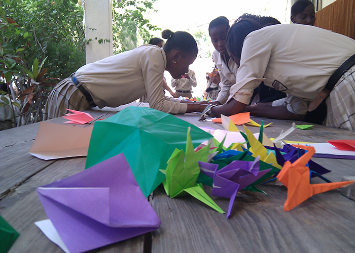Students in Haiti making cranes for the Challenge!
